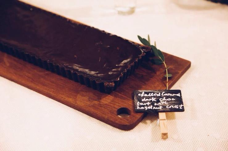 Dark chocolate tart with salted caramel and hazelnut crust